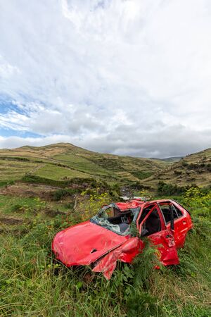 An abandoned car in the pasture area of northern Flores in the Azores, Portugal.