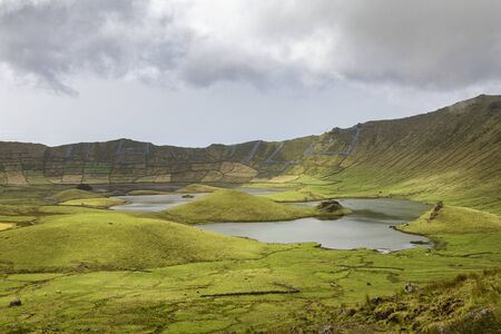 Afternoon clouds above the lakes inside the Corvo Crater on the island of Corvo in the Azores, Portugal.