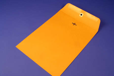 Manilla envelope on a blue background