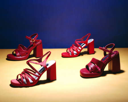 fashon: Red heals on a blue and yellow background Stock Photo