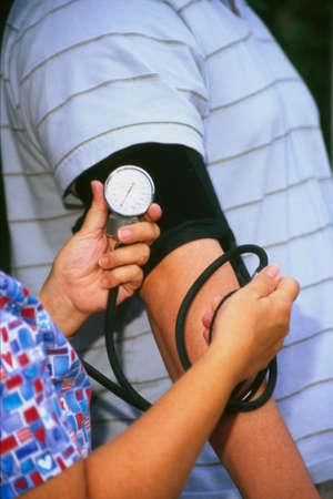Nurse taking a mans blood pressure