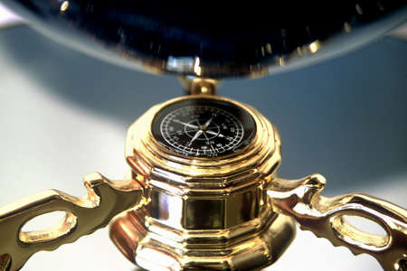 Compass attached to bottom of a globe