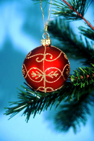 beaded: Beaded Christmas ornament hanging from tree branch Stock Photo