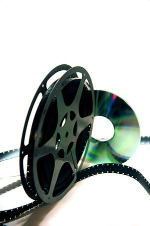 16mm movie reel and a dvd on a white background