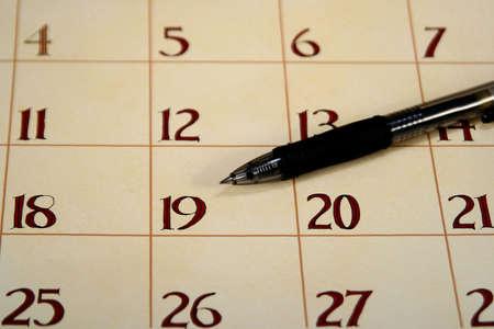 Close up of a calendar with a pen Stock Photo