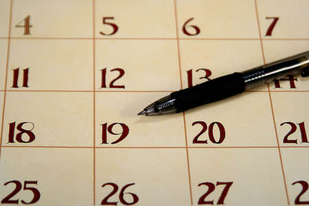 Close up of a calendar with a pen Stock Photo