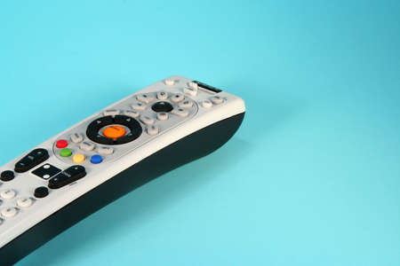 Colorful remote control on a light blue background Stock Photo