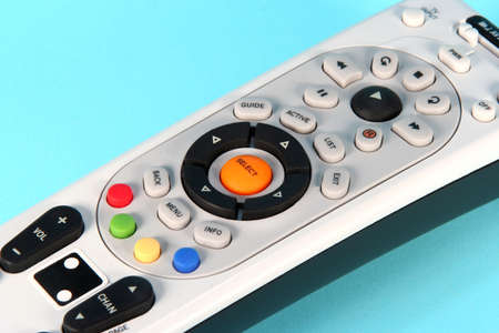 clicker: Colorful remote control on a light blue background Stock Photo
