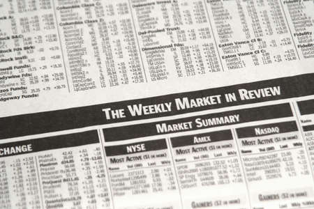 corporate greed: Stock market pages in newspaper