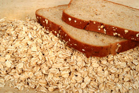 quaker:  Bread and oatmeal on a cutting board Stock Photo