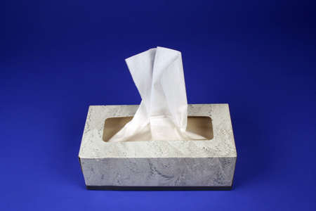 facial tissue: Box of tissue on a blue background