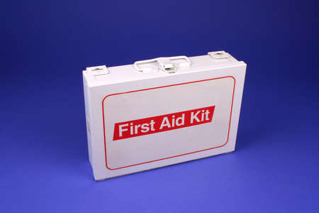 Horizontal photo of a first aid kit on a blue background