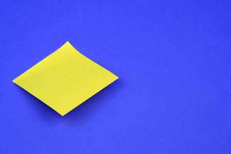 Blank post-it on a blue background photo