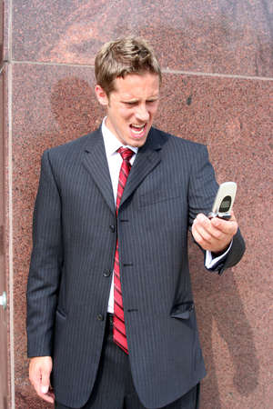 Business man screaming into cell phone