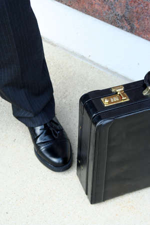 Close up of shoe and briefcase photo