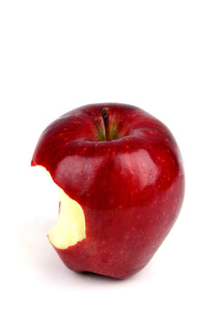 Red apple with a bite taken out of it on a white background