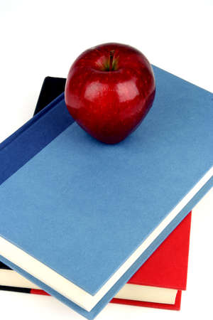 Red apple on a blue and red book Banco de Imagens