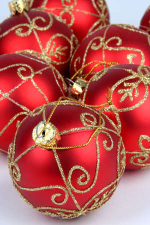 Red and gold christmas balls with focus on ball in front photo