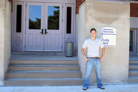 coed:  Student standing in front of building on college campus Stock Photo