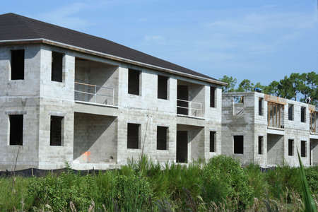 New homes under construction showing foundation Imagens