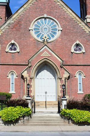 Front of church showing doors and windows photo