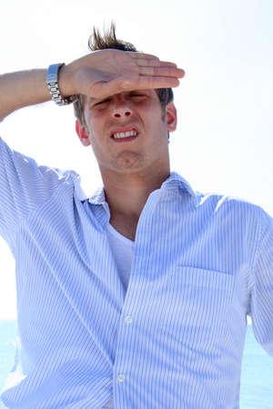 Man wiping sweat from forhead