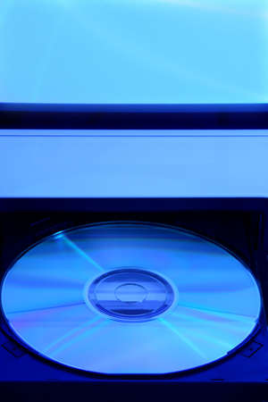 CD rom in open drive of compputer with a blue tone
