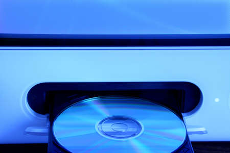 cd rom: CD rom in open drive of compputer with a blue tone