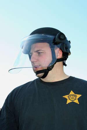 dwi: Police man wearing helmet looking to the side