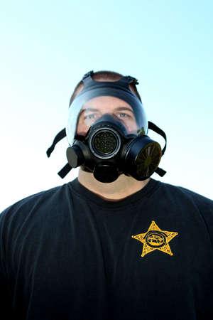 dwi: Policeman wearing a gas mask looking at camera