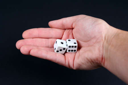 Two dice in hand on a black background Stock Photo - 635074