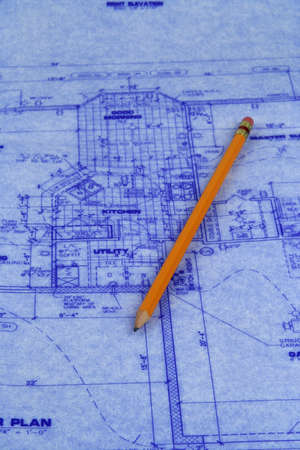 Pencil laying on a blueprint of house photo