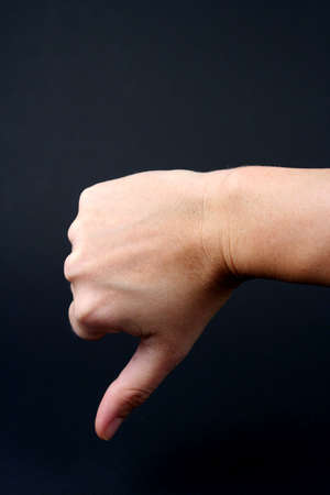 Hand in thumbs down sign Stock Photo - 656683