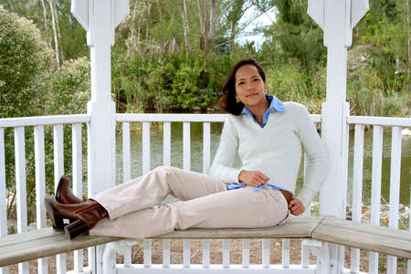 Photo of an attractive young woman lounging  on a bench Stock Photo - 656655