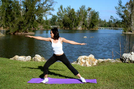 Female in park doing yoga poses Stock Photo - 678168