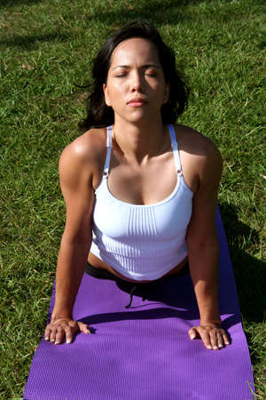 Woman at a park doing yoga poses Stock Photo - 678166