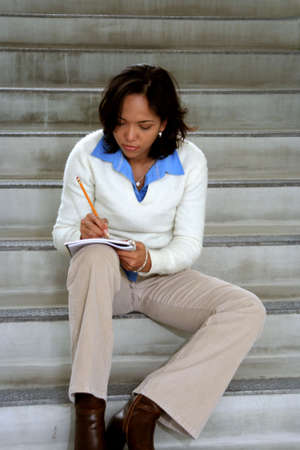 Student with a notebook looking thoughtful