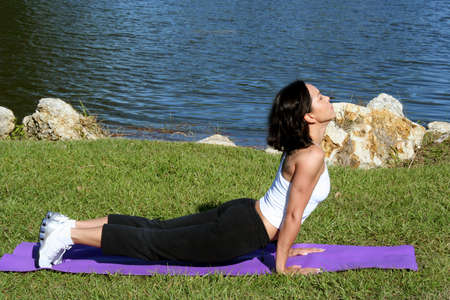 muscle toning: Woman at a park doing yoga poses