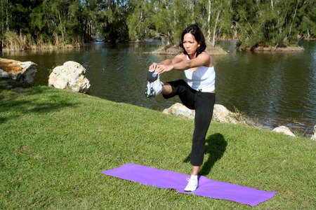 Female in park doing yoga poses photo