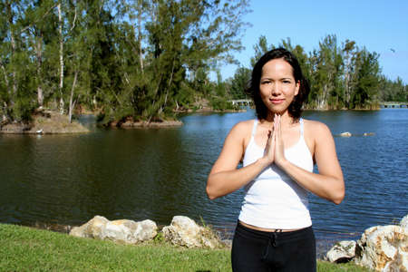 Woman at a park doing yoga poses Stock Photo - 687093