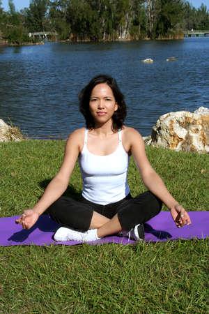 Female in park doing yoga poses photo