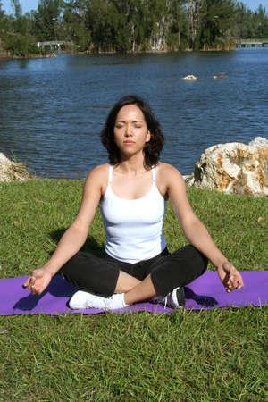 Female in park doing yoga poses