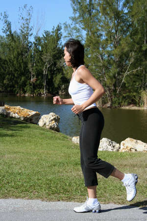 Female running outside at a park photo