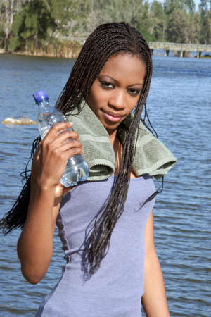 Young woman taking a water break after exercising Archivio Fotografico