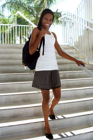 Female student walking down steps on campus Stock Photo - 689106