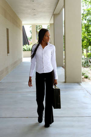 Young businesswoman holding a briefcase photo