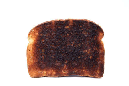 burnt toast: Piece of burnt toast on a white background