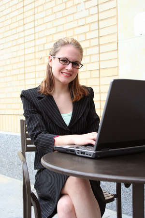 Businesswoman working at computer at an outside coffee shop Stock Photo - 773052