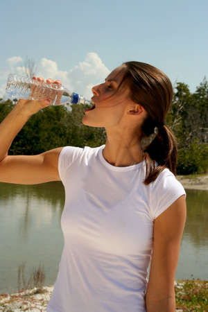 Attractive woman  taking a fitness break with water Stock Photo - 840288