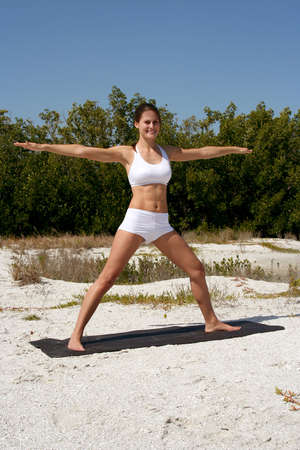 Attractive woman on beach doing yoga poses Stock Photo - 840286
